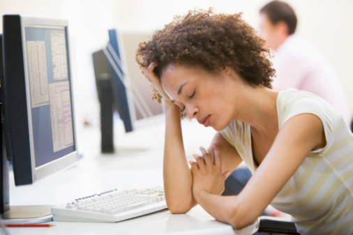 woman tired at work pf